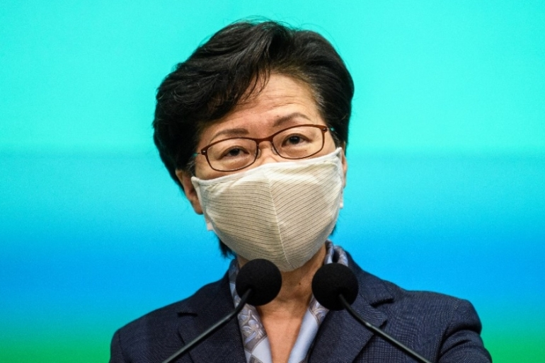 Carrie Lam speaks during her weekly news conference in Hong Kong on June 9, a year since more than a million people marched through the city in opposition to a planned extradition bill [Anthony Wallace/AFP]