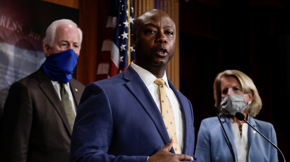 U.S. Senator Tim Scott (R-SC) is flanked by Senators Shelley Moore Capito (R-WV) and John Cornyn (R-TX) as he speaks about his new police reform bill unveiled by Senate Republicans during a news confe