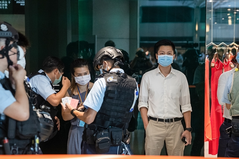 Police detain pro-democracy protesters during a rally at a shopping mall in Hong Kong, China, on June 30, 2020 [Jerome Favre/ EPA]