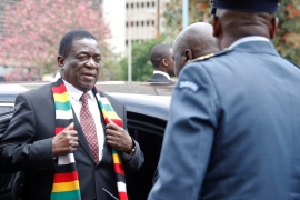 Zimbabwe President Emmerson Mnangagwa arrives for the presentation of the 2020 National Budget at Parliament Building in Harare, where the local currency has tumbled on the black market, fuelling price increases and pushing inflation to 765 percent [File: Philimon Bulawayo/Reuters]