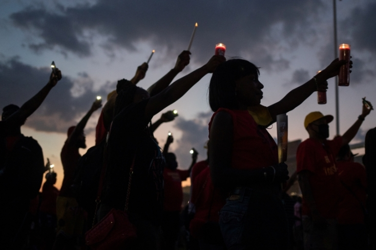Local residents and alumni of Yates high school take part in a candlelight vigil honoring George Floyd, whose death in Minneapolis police custody has sparked nationwide protests against racial inequality [Adrees Latif/Reuters]