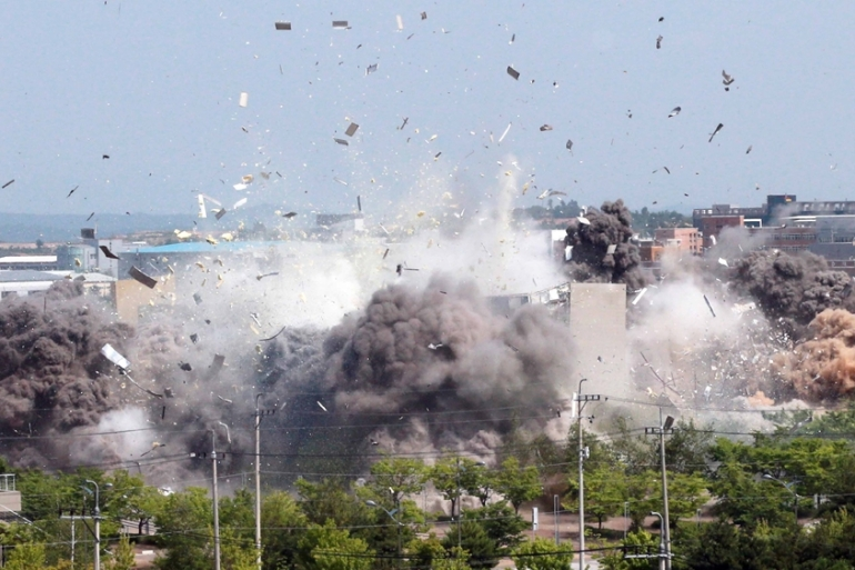 North Korea's state media shared pictures of Monday's destruction of the joint liaison office with South Korea in the border town of Kaesong [KCNA via Reuters]