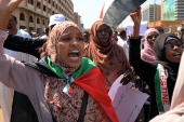 Women chant slogans in Khartoum to protest against the contentious decision of the president of the Sovereign Council, Abdel Fattah al-Burhan, to meet Israel's prime minister last February in a move towards normalising relations [File: Marwan Ali/AP]