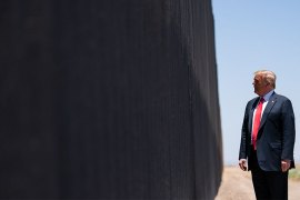 President Donald Trump tours a section of the border wall, which he said 'stopped COVID, it stopped everything', in San Luis, Arizona on Tuesday [Evan Vucci/AP Photo]