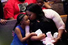Roxie Washington, right, and Gianna Floyd, daughter of George Floyd, at the funeral service in the chapel at the Fountain of Praise church. [David J. Phillip/Pool via Getty Images/AFP]
