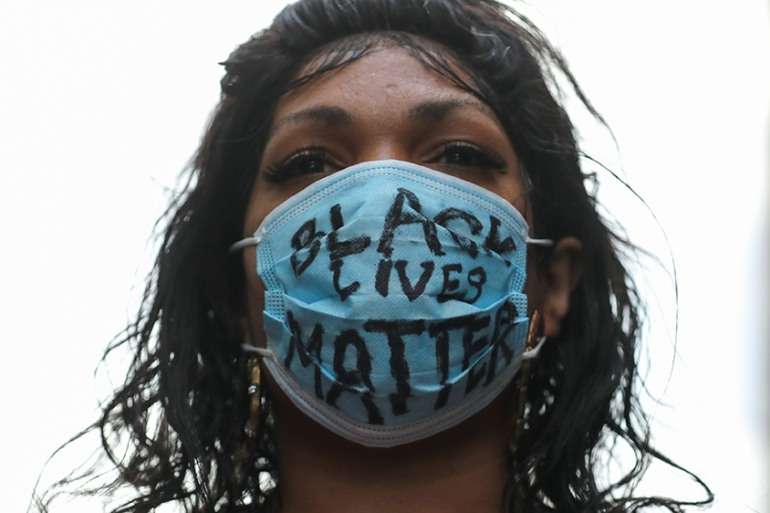 A demonstrator in New York City wears a protective face mask reading 'Black lives matter' - one of tens of thousands of people in the US who are protesting against police brutality and racial inequality following the death of George Floyd in police custody in Minneapolis [File: Jeenah Moon/Reuters]