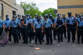 Minneapolis police faced protesters demonstrating against the death of George Floyd outside the 3rd Precinct Police Precinct in Minneapolis, in June 2020, amid calls by city politicians to disband the department [File: Kerem Yucel /AFP]