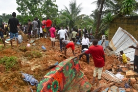 People search for survivors and bodies on the site of a landslide in Anyama, near Abidjan, Ivory Coast [Sia Kambou/AFP]