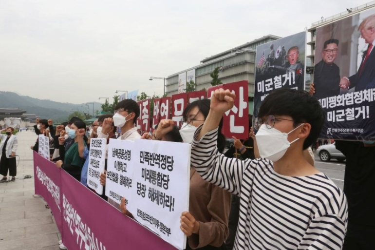 South Korean protesters stage a rally to denounce US and South Korean policies on North Korea near the US embassy in Seoul [Ahn Young-joon/AP]