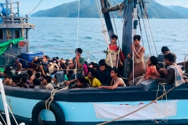In this handout photo released on April 5, 2020 by the Malaysian Maritime Enforcement Agency, a boat carries suspected Rohingya refugees detained in Malaysian territorial waters off the island of Langkawi [AP Photo]