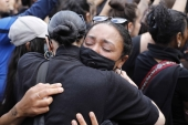 Women hug as people gather at the Alexander Platz in Berlin, Germany on June 6, 2020, to protest against the recent killing of George Floyd by police officers in Minneapolis, US [AP/Markus Schreiber]