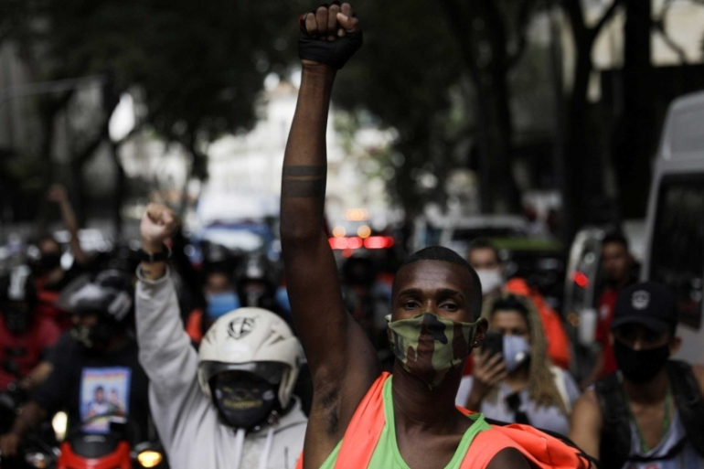 Delivery apps workers participate in a strike demanding better working and paying conditions amid the outbreak of the coronavirus disease in Rio de Janeiro, Brazil [Ricardo Moraes/Reuters]