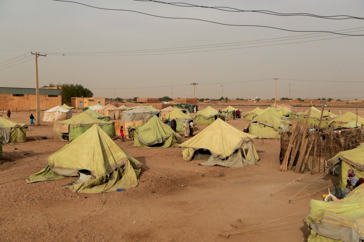 Tents belonging to people who were displaced when the Nile overflowed last year stand together in Wad Ramli, Sudan. Residents displaced by flooding last summer see a benefit in a dam that will regulate the powerful river's waters. [Zohra Bensemra/Reuters]