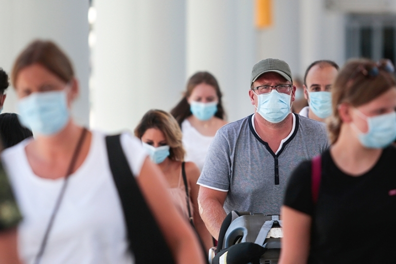 Some governments have urged the public not to wear masks in order to ensure enough supplies for healthcare workers [File: Joan Mateu/AP]
