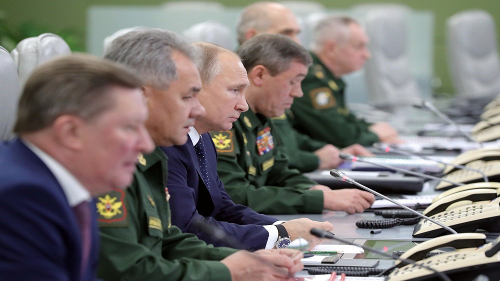 Russian President Vladimir Putin third from left at the National Defence Control Centre to oversee the test of a new Russian hypersonic missile system called Avangard which can carry nuclear and conventional warheads in Moscow Russia