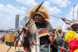 Haacaaluu Hundeessaa rides a horse in traditional costume during the 123rd anniversary celebration of the Battle of Adwa where Ethiopian forces defeated the invading Italian forces, in Addis Ababa last year [File: Tiksa Negeri/Reuters]