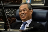 Malaysian Prime Minister Muhyiddin Yassin's Perikatan Nasional coalition and its allies won 38 of the 73 seats up for grabs in Saturday's election [File: Lim Huey Teng/Reuters]