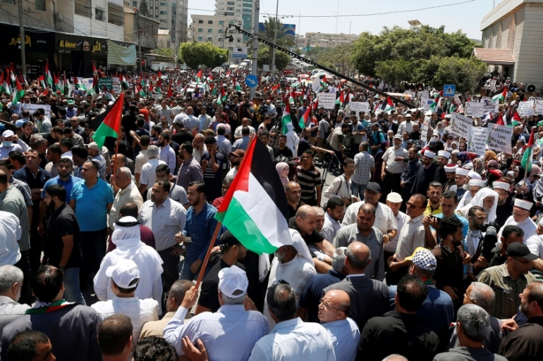 Palestinians are gathering in Gaza City and occupied West Bank for demonstrations against the Israeli plan [Mohammed Salem/Reuters]