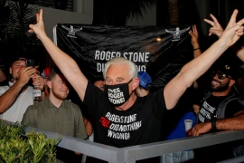 Roger Stone, a longtime friend and adviser of United States President Donald Trump, reacts after Trump commuted his federal prison sentence, outside his home in Fort Lauderdale, Florida on Friday [Joe Skipper/Reuters]  [Reuters]