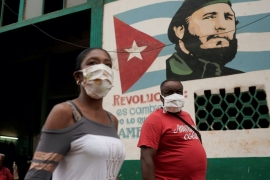 People wearing protective masks amid concerns about the spread of the coronavirus in Havana, Cuba, which President Miguel Diaz-Canel said will be implementing a series of reforms to stimulate its economy [File: Alexandre Meneghini/Reuters]