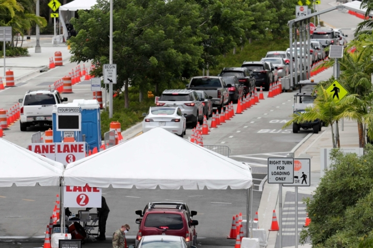 The Florida National Guard directs vehicles at a COVID-19 testing site in Miami Beach, Florida [AP Photo/Lynne Sladky]