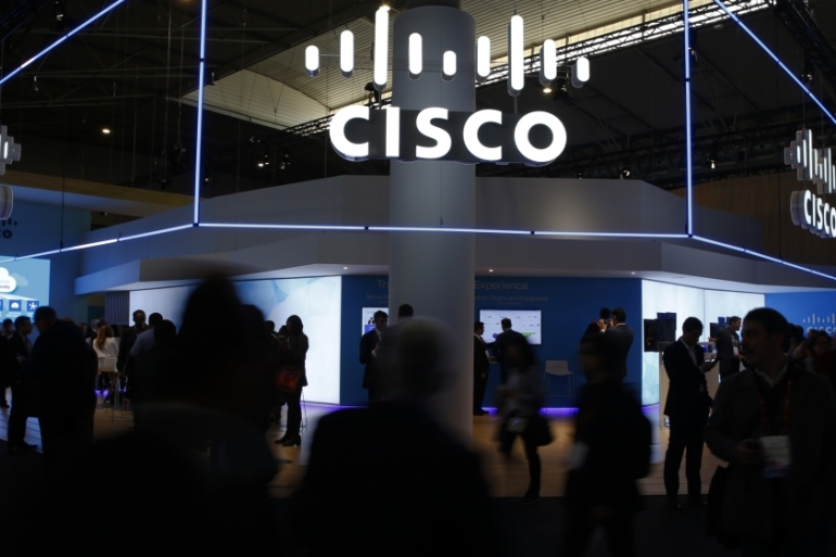 Visitors walk past Cisco's booth during Mobile World Congress in Barcelona, Spain on February 27, 2017 [File: Reuters/Paul Hanna]