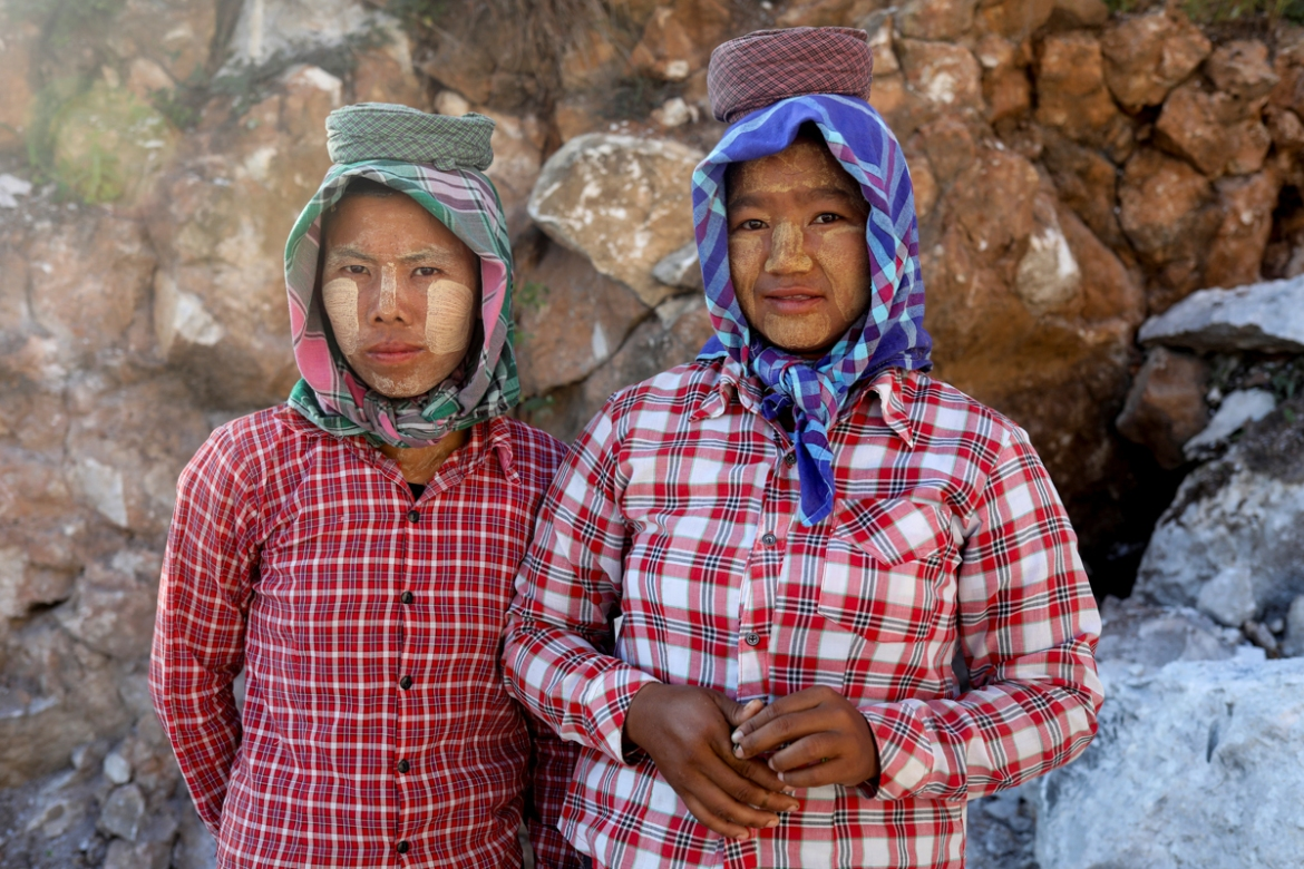 Mya Lay, 25, left, and one of her colleagues pose for a photo at the marble mine in Sagyin. 'I was born in this village and for generations, this is what we have done: the men work on marble carving and the women work in the marble mines or polish the marble statues,' said Lay. For years, she has walked down from the mines from morning till sunset carrying large marble slabs on her head, laborious work for about $3.50 a day. 'If I could I would leave the village and find a job in the city,' she said, adding that she wanted a better life for her daughter. [Ann Wang/Reuters]
