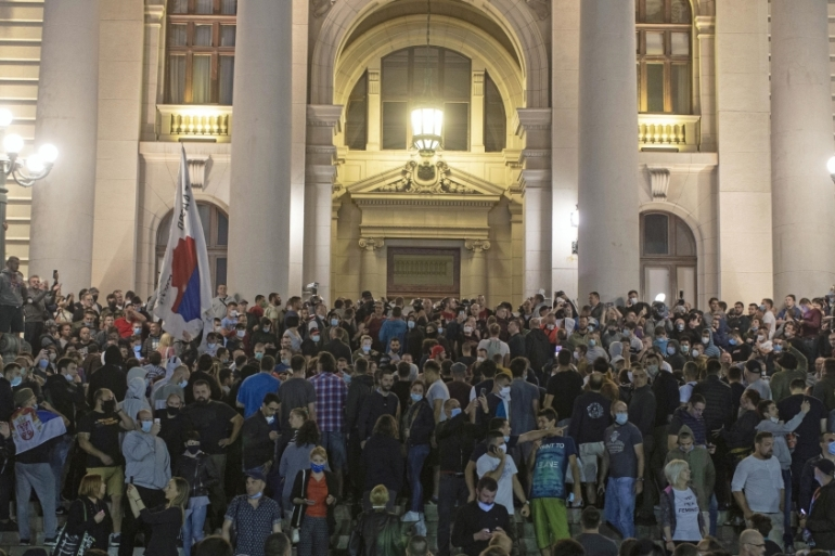 Protesters gather in front of the Serbian parliament after the president announced the imposition of a curfew due to the COVID-19 outbreak in Belgrade on July 7, 2020 [File: Marko Drobnjakovic/AP]
