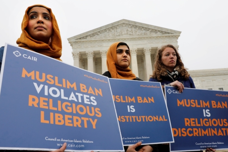 Protesters gather outside the US Supreme Court against President Donald Trump's travel ban on people from Muslim-majority countries in Washington, DC in 2018 [Yuri Gripas/Reuters]