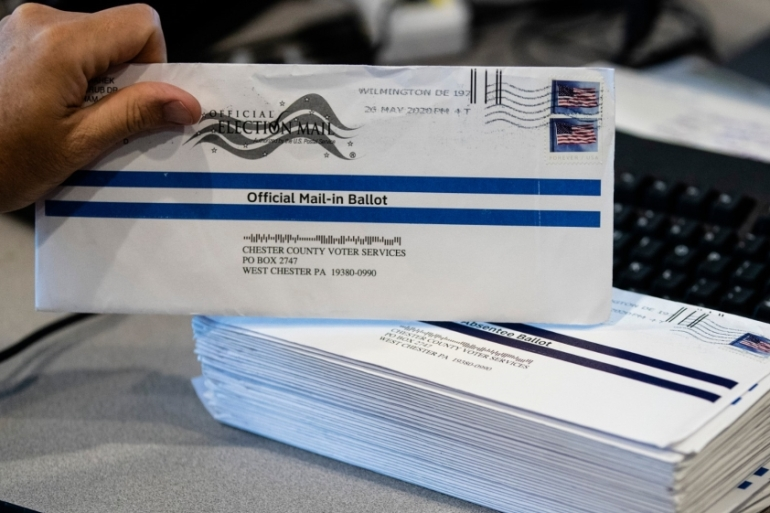 Mail-in voting is expected to be widespread in November's election, which could lead to delays in results [File: Matt Rourke/The Associated Press]