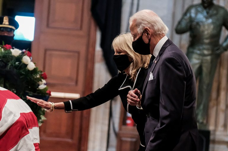 Democratic presidential candidate Joe Biden and his wife, Jill, were among those who paid their respects to Congressman John Lewis at the US Capitol on Monday. [Michael A. McCoy/Pool via Reuters]