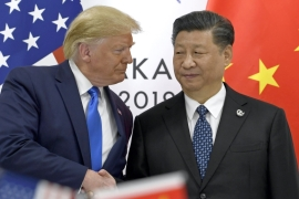 President Donald Trump shakes hands with President Xi Jinping during a meeting in Japan in 2019 [Susan Walsh/AP]