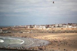 People in Sale, northwestern Morocco, at a reopened beach after the lifting of lockdown measures imposed three months ago to curb the spread of coronavirus. [Mosa'ab Elshamy/AP Photo]