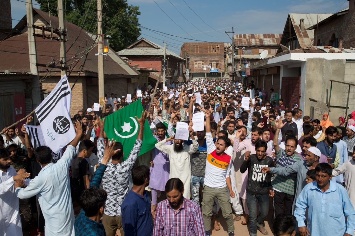 Kashmiris shout slogans during a protest after Eid prayers during a security lockdown in Srinagar on August 12, 2019. Hundreds of worshippers gathered after the prayers and chanted 'We want freedom' and 'Go India, Go back', witnesses said. [Dar Yasin/AP Photo]