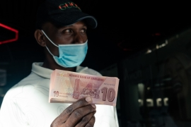 The country's currency, the Zimbabwe dollar, has virtually collapsed [File: Jekesai Njikizana/AFP]