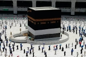 Hundreds of Muslim pilgrims circumambulate the Kaaba, the cubic building at the Grand Mosque, as they keep social distance to protect themselves from the coronavirus [File: AP]