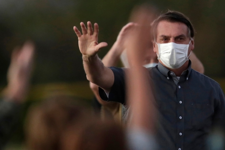 Bolsonaro announced he has tested negative for the novel coronavirus on Twitter [Eraldo Peres/AP Photo]
