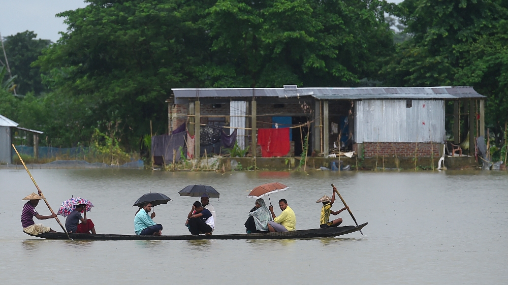 BANGLADESH-INDIA-NEPAL-WEATHER-FLOOD  People ride on a boat through flooded waters in Sunamgong on July 14, 2020. Almost four million people have been hit by monsoon floods in South Asia