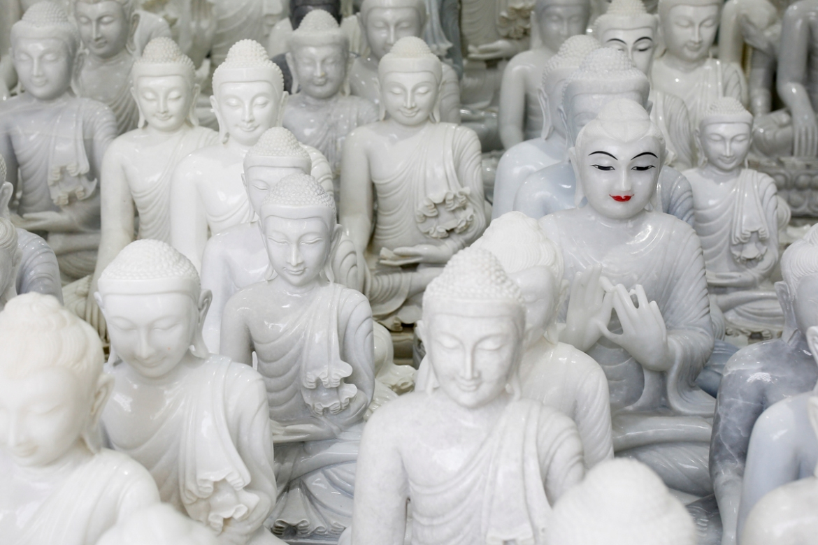 Marble statues that were made in Sagyin, are displayed for sale in a shop at the village, Mandalay. [Ann Wang/Reuters]