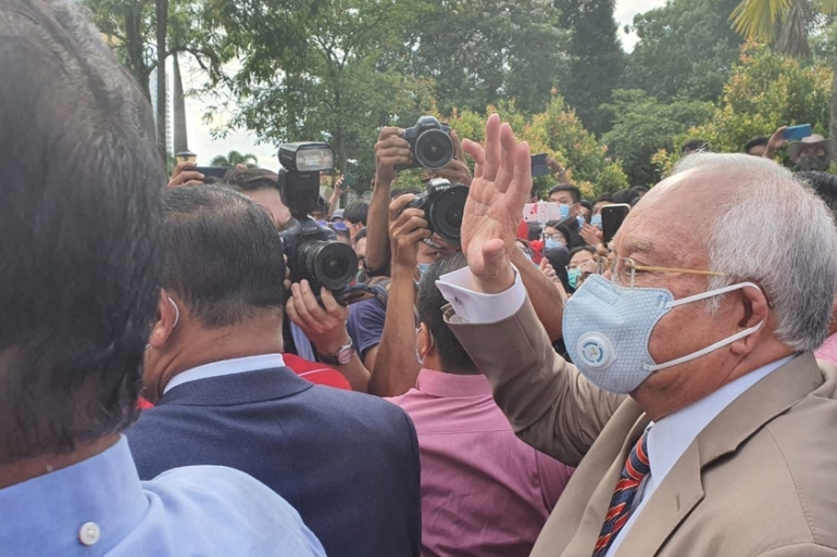 Malaysia's former Prime Minister Najib Razak arrives at court on Tuesday morning. A judge found him guilty on all seven counts [Ted Regencia/Al Jazeera]