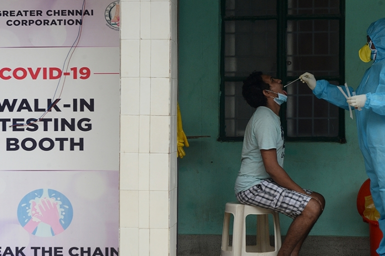 A health worker takes swab sample from a man to test for the coronavirus at a testing centre in Chennai [Arun Sankar/AFP]