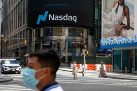 The Nasdaq 100 saw its biggest rally since April as investors were buoyed by an increase in COVID-19 vaccinations and hopes that United States President Joe Biden's $1.9 trillion stimulus bill will be passed this week [File: Michael Nagle/Bloomberg]