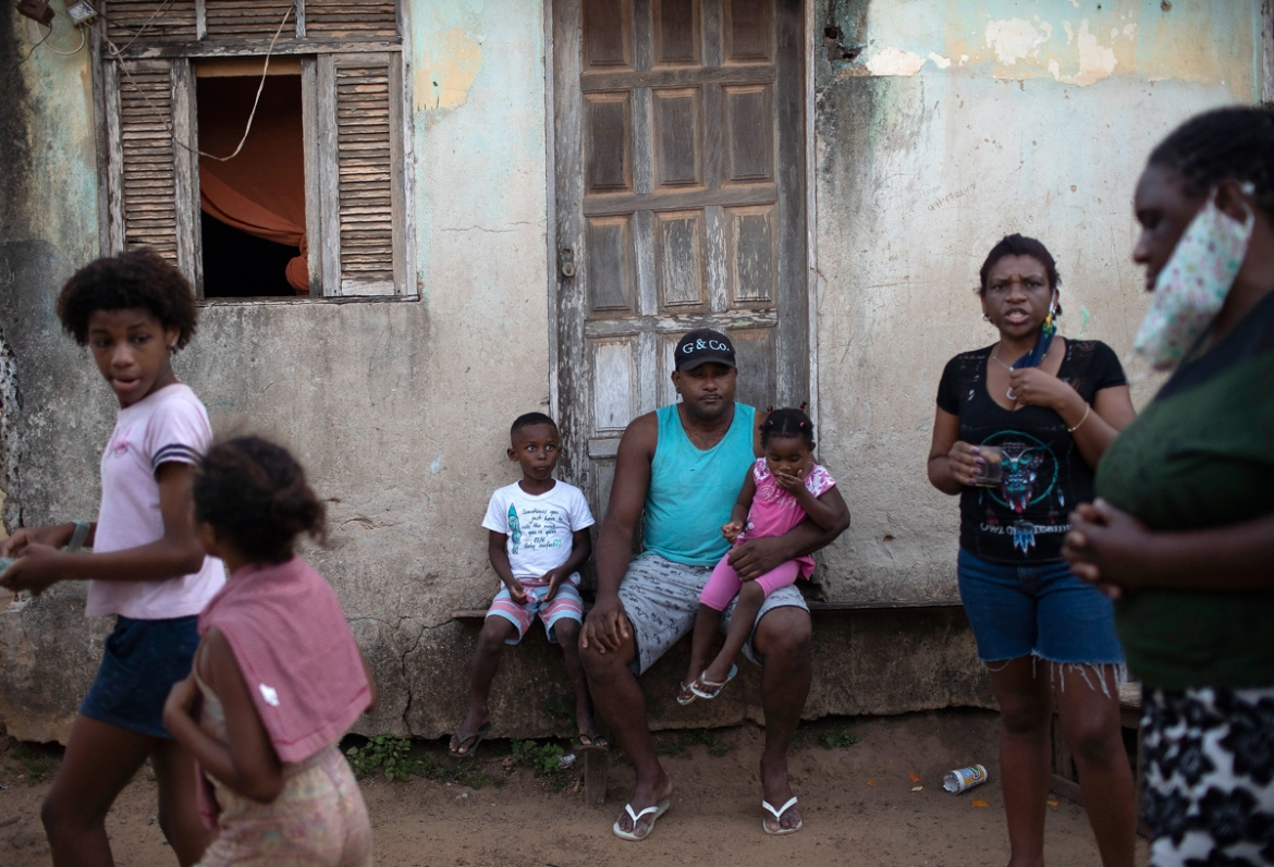 Residents of the Maria Joaquina quilombo wait for the distribution of kits of donated food, cleaning products and protective face masks. Brazil's quilombos are settlements established by runaway slaves and still inhabited by their descendants. [Silvia Izquierdo/AP Photo]