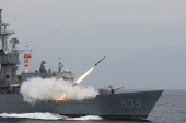 An anti-submarine missile blasts off from a frigate during a military drill near Hualien in Taiwan in May 2019 [Tyrone Siu/Reuters]