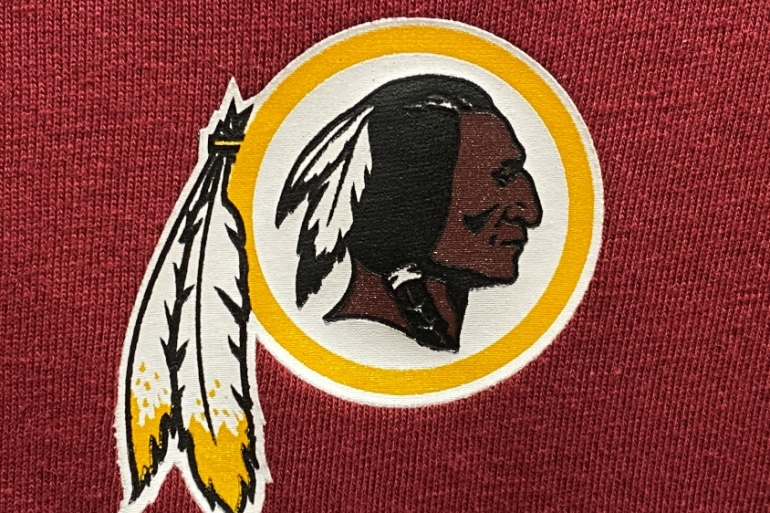 A Washington Redskins football team logo is seen on a shirt at a sporting goods store in Virginia, the United States [Kevin Lamarque/Reuters]