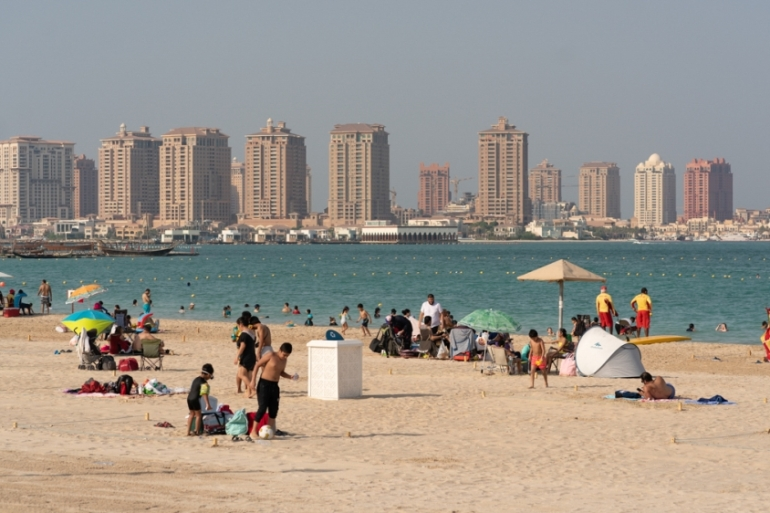 People in Qatar cautiously returned to beaches as the Gulf nation reopens following a coronavirus outbreak [Sorin Furcoi/Al Jazeera]
