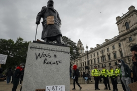 Protesters and police gather around the statue of Winston Churchill in Parliament Square during the Black Lives Matter protest rally in London, Sunday, June 7, 2020 [AP Photo/Frank Augstein]