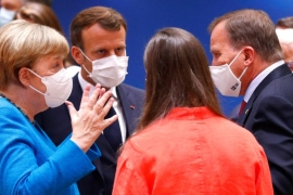 After the meeting on Saturday, German Chancellor Angela Merkel and French President Emmanuel Macron were seen haggling with members of the Dutch-led camp, who are demanding cuts to the 1.8 trillion euro ($2.06 trillion) package [Francois Lenoir/Pool Photo via AP]