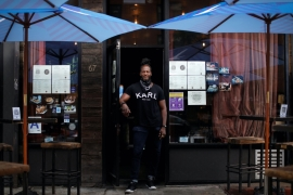 Karl Franz Williams, founder and owner of 67 Orange Street, a bar and restaurant in Harlem, New York, United States, where a rising stock market alongside 11 percent unemployment presents a quandary over economic fairness [File: Mike Segar/Reuters]