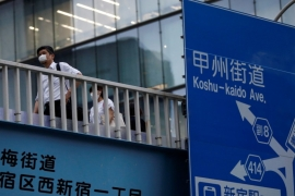 Japan's seven-year office boom has been shattered by the COVID-19 pandemic and analysts say the trend is expected to continue until the end of this year [File: Issei Kato/Reuters]